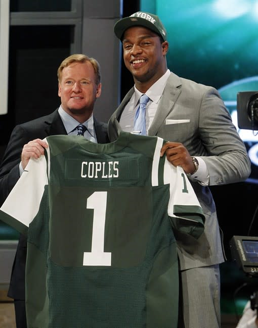 North Carolina defensive end Quinton Coples, right, poses for photographs with NFL Commissioner Roger Goodell after being selected as the 16th pick overall by the New York Jets in the first round of the NFL football draft at Radio City Music Hall, Thursday, April 26, 2012, in New York. (AP Photo/Jason DeCrow)
