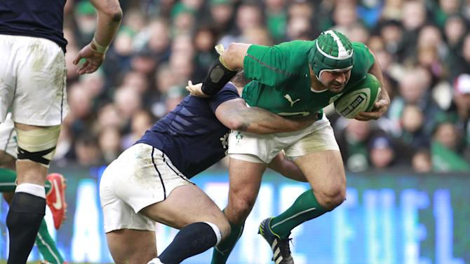 Ireland's Rory Best, right, is tackled by Scotland's Ross Ford during their Six Nations Rugby Union international match at the Aviva Stadium, Dublin, Ireland, Sunday, Feb. 2, 2014. (AP Photo/Peter Morrison)