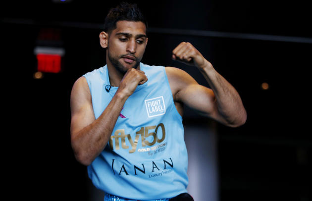 Boxing: Amir Khan poses after the press conference