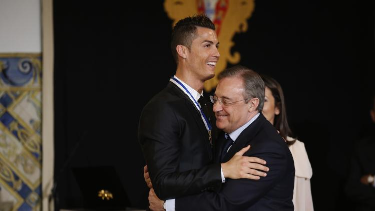 Portugal's soccer team captain Ronaldo hugs with Real Madrid's President Perez after receiving the Ordem do Infante Dom Henrique in Lisbon