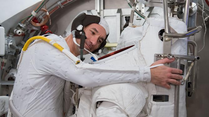 In this March 4, 2013 photo made available by NASA, European Space Agency astronaut Luca Parmitano participates in an Extravehicular Mobility Unit (EMU) spacesuit fit check in the Space Station Airlock Test Article (SSATA) of the Crew Systems Laboratory at NASA's Johnson Space Center in Houston. The Italian astronaut who nearly drowned during a spacewalk in July 2013 is sharing more details about the experience. Parmitano wrote in his online blog, posted Tuesday, Aug. 20, 2013 that he felt all alone as water filled his helmet outside the International Space Station. (AP Photo/NASA, Lauren Harnett)