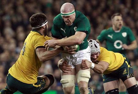 Ireland's O'connell is challenged by Australia's Simmons and Mowen in their International rugby union match in Dublin