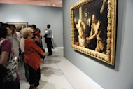 Visitors look at a painting by Italian artist Michelangelo Merisi, known as Caravaggio, in June 2012 at the Fabre Museum in Montpellier, France. Italian art experts have reportedly discovered around 100 drawings and a number of paintings by the young Renaissance master Caravaggio in a find that could be worth up to 700 million euros