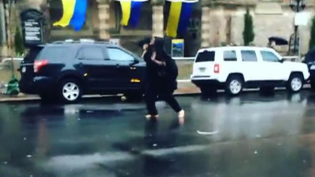 "Watch: Barefoot, veiled man shouts ""Boston Strong"" on city street"