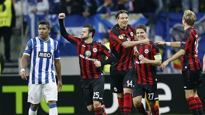 Frankfurt's Alexander Meier, center, and Frankfurt's Tranquillo Barnetta, left, and Pirmin Schwegler of Switzerland celebrate their side's second goal during a Europa League round of 32 second leg soccer match between Eintracht Frankfurt and FC Porto in Frankfurt, Germany, Thursday, Feb. 27, 2014