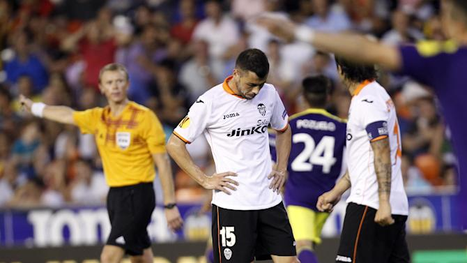 Valencia's Javi Fuego, looks towards the ground after his team conceded a goal against Swansea City during their  Europa  League Group A soccer match at the Mestalla stadium in Valencia, Spain, Thursday , Sept. 19, 2013