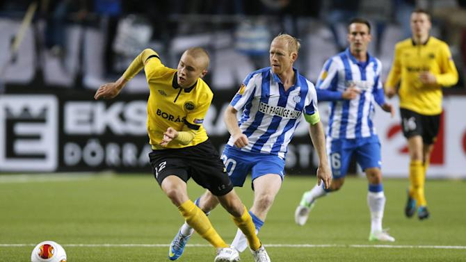 Elfsborg's Sebastian Holmen, left, is challenged by Esbjerg's Hans Henrik Andreasen during the group C Europa League match at the Boras Arena in Boras, Sweden, Thursday Oct. 24, 2013