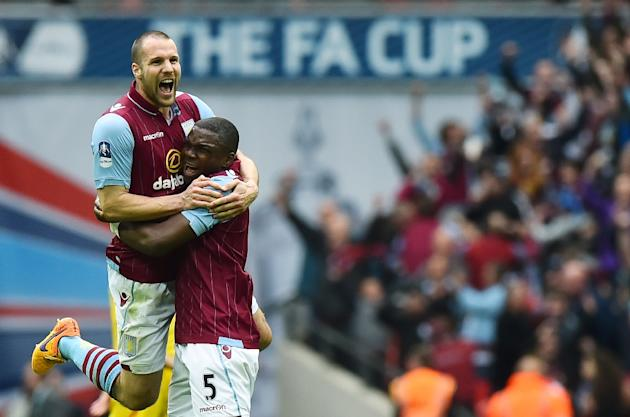 Aston Villa's Ron Vlaar (L) and Jores Okore celebrate after winning the FA Cup semi-final against Liverpool at Wembley stadium on April 19, 2015
