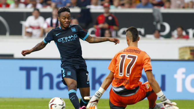Manchester City's Raheem Sterling passes the ball to Edin Dzeko before he scores their second goal