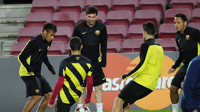 FC Barcelona Neymar, from Brazil, left, and Lionel Messi, from Argentina, third left, attend a training session at the Camp Nou in Barcelona, Spain, Tuesday, Nov. 5, 2013.  FC Barcelona will play against AC Milan in a group H Champions League soccer match on Wednesday Nov. 6