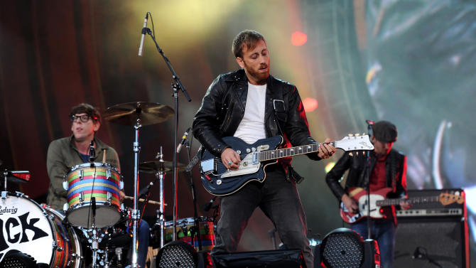 FILE - In this Sept. 29, 2012 file photo, guitarist Dan Auerbach, center, and drummer Patrick Carney of The Black Keys perform at the Global Citizen Festival in Central Park, in New York. Dan Auerbach received one nomination and the band got five nominations for the 55th annual Grammy Awards, announced Wednesday night, Dec. 5, 2012, at Bridgestone Arena in Nashville, Tenn.  (AP Photo by Evan Agostini/Invision/AP, File)