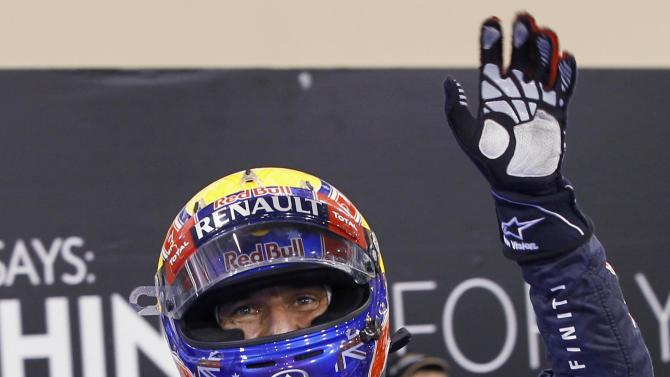 Red Bull Formula One driver Webber of Australia waves after taking pole position during the qualifying session of the Abu Dhabi F1 Grand Prix at the Yas Marina circuit on Yas Island