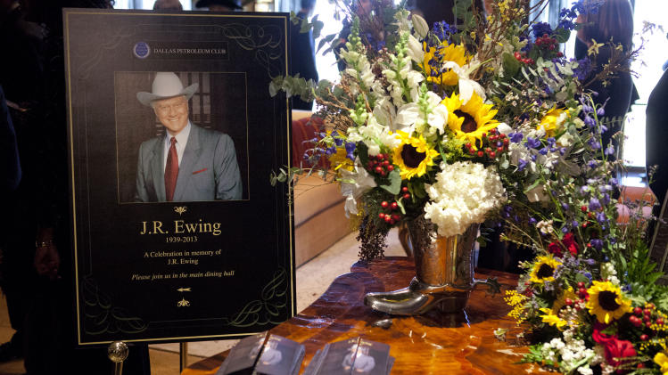 "This image released by TNT shows a funeral scene for the character J.R. Ewing, played by Larry Hagman, in an episode of ""Dallas,"" airing Monday at 9 p.m. EST on TNT. Hagman died of cancer at 81 the day after Thanksgiving.  (AP Photo/TNT, Skip Bolen)"