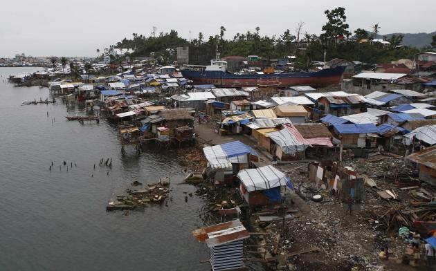 A view of temporary shelters for typhoon survivors that were constructed next to a ship that ran aground is pictured in Tacloban city