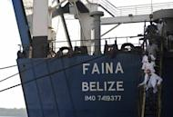 MV Faina's owner Zadim Alperin (bottom) inspects the ship on February 12, 2009 after its release by Somali pirates. Mohamed Abdi Hassan's men were reportedly involved in the 2009 capture of the MV Faina, a Ukrainian transport ship carrying 33 refurbished Soviet-era T-72 battle tanks, and which was released after a 134-day hijack for a reported $3 mn.