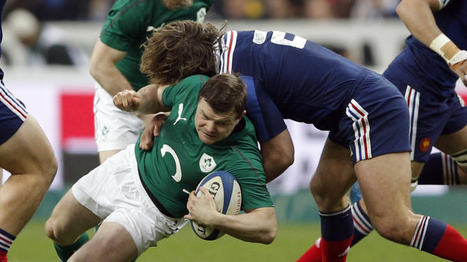 Ireland's Brian O'Driscoll is tackled by France's Dimitri Szarzewski during the Six Nations Rugby Union match between France and Ireland at the Stade de France stadium, in Saint Denis, outside Paris, Saturday, March 15, 2014. (AP Photo/Christophe Ena)