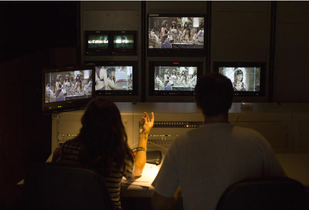 """In this May 13, 2015 photo, a director, left, coordinates the scenes from a control room during the production of Brazil's prime-time soap opera """"The Ten Commandments"""" at a RecNov studio in"""