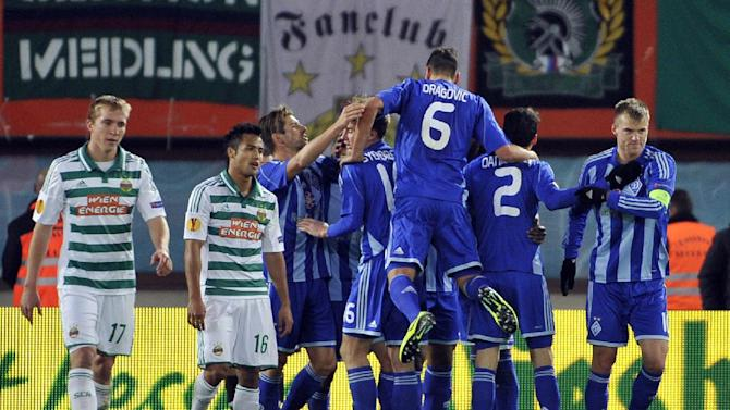 Kiev's players, right, celebrate after scoring next to Rapid's Christopher Dibon and Stephan Palla, from left, during their Europa League second round group G soccer match between SK Rapid Wien and FC Dynamo Kiev, in Vienna, Austria, Thursday, Oct. 3, 2013