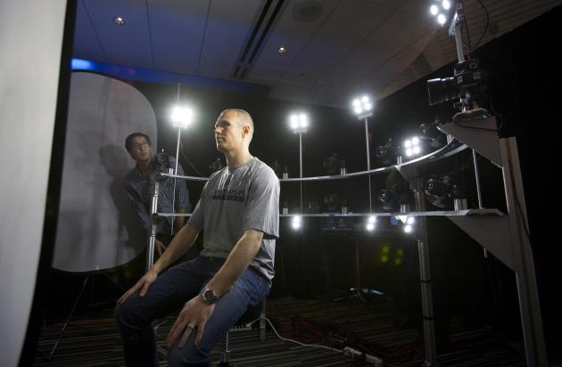 Kenny Miller of the Vancouver Whitecaps soccer team has his face captured by the Capture Lab members while visiting the Electronic Arts campus in Burnaby, British Columbia