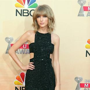 FILE - In this March 29, 2015 file photo, Taylor Swift arrives at the iHeartRadio Music Awards in Los Angeles. Swift revealed to her fans that her mother has cancer in a post on her Tumblr on Thursday, April 9, which her representative confirmed. (Photo by John Salangsang/Invision/AP, File)