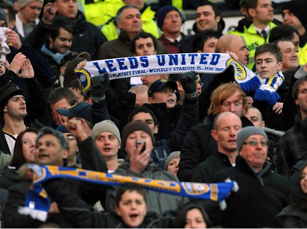 Leeds United supporters celebrate after their team beat Manchester United at Old Trafford in Manchester, England, on January 3, 2010