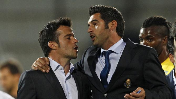 Porto's coach Fonseca chats with Estotril's coach Silva at the end their Portuguese Premier League soccer match at the Coimbra da Mota stadium in Estoril