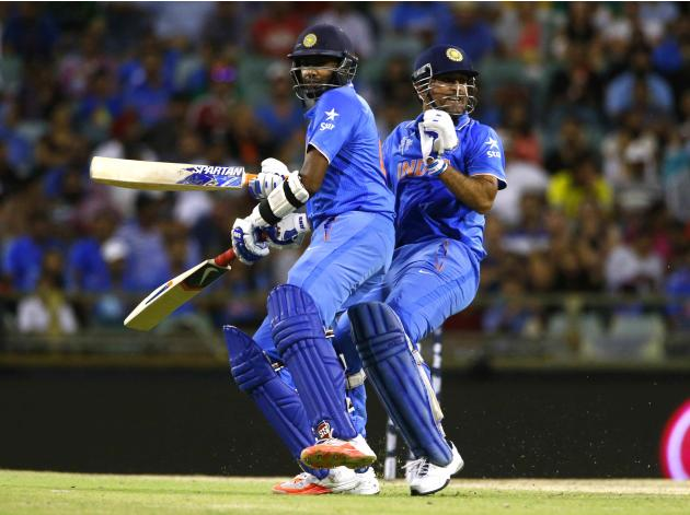 Indian batsmen Ravichandran Ashwin and MS Dhoni collide on the pitch as they gather runs during their win against the West Indies at the Cricket World Cup in Perth