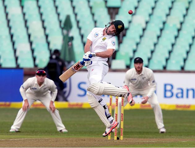 South Africa's Stephen Cook avoids a short pitched delivery during the first cricket test match against New Zealand in Durban