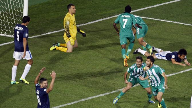 Oulhaj and Moutaouali of Raja Casablanca celebrate during their FIFA Club World Cup soccer match against Auckland City FC at Agadir Stadium in Agadir