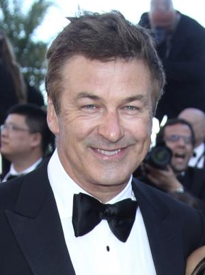"""FILE - This May 22, 2012 file photo shows actor Alec Baldwin arriving for the screening of """"Killing Them Softly"""" at the 65th international film festival, in Cannes, southern France. New York City police are investigating harassment complaints made by actor Alec Baldwin and a New York Post photographer after an altercation outside Baldwin's  Manhattan apartment. According to police, photographer G.N. Miller says the former """"30 Rock"""" star yelled racial epithets and other insults when he was trying to take pictures of the actor outside his Manhattan apartment. Baldwin maintains he hollered at the photographer, but never said anything racist. He called the allegations """"outrageous."""" Baldwin called police and filed a harassment complaint Monday, Feb. 18, 2013, after the incident.  (AP Photo/Joel Ryan, file)"""