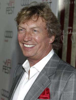 "In this Nov. 3, 2011 photo, Nigel Lythgoe arrives at the premiere of ""J. Edgar"" during the Opening Night Gala of AFI FEST 2011 in Los Angeles. Lythgoe, 62, who returned as ""American Idol's"" executive producer last season after a two-year hiatus, will be presented the honorary International Emmy Founders Award on Monday, Nov. 21, 2011, at the Hilton New York Hotel in recognition of his work as ""a major reality show producer and innovator"" as well as for ""his amazingly deep commitment to dance around the world,"" said Bruce L. Paisner, president and CEO of the International Academy of Television Arts & Sciences. (AP Photo/Matt Sayles)"