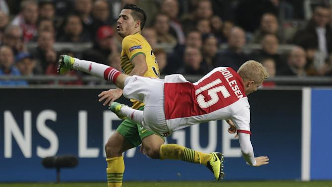 Ajax's Nicolai Boilesen, right, and Celtic's Emilio Izaguirre, rear, vie for the ball during the Champions League Group H soccer match between Ajax Amsterdam and Celtic Glasgow at ArenA stadium in Amsterdam, Netherlands, Wednesday, Nov. 6, 2013