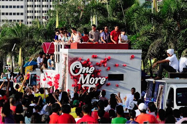 "The casts of the MMFF 2012 entry ""One More Try"" are seen as their float makes its way through the crowd at the 2012 Metro Manila Film Festival Parade of Stars on 23 December 2012. (L-R) Angel Locsin,"