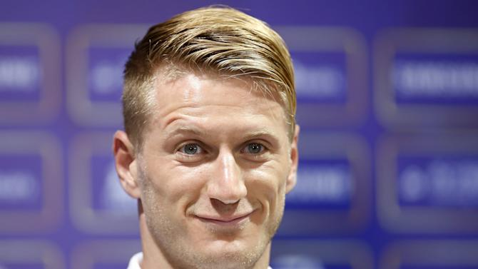 A.C. Milan soccer player Reus attends a news conference ahead of a friendly match against Real Madrid in Shanghai