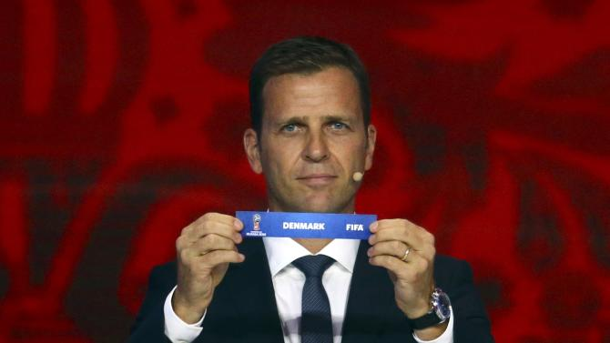 "Former German soccer player Bierhoff holds up the slip showing ""Denmark"" during the preliminary draw for the 2018 FIFA World Cup at Konstantin Palace in St. Petersburg"