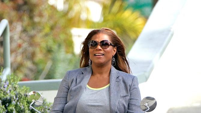 Queen Latifah rides a scooter while filming scenes for an upcoming project in Los Angeles