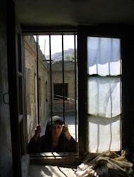 "File photo shows a Afghan woman prisoner in Kabul. In Afghanistan's deeply conservative society many inmates fear they could be murdered by their families for reasons of ""honour"" after they are released from prison"