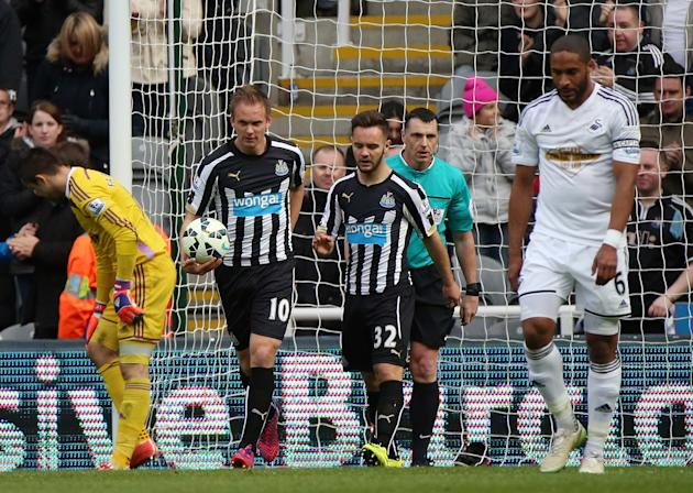 Newcastle United's Siem De Jong, second left, celebrates his goal during their English Premier League soccer match between Newcastle United and Swansea City at St James' Park, Newcastle, Engla