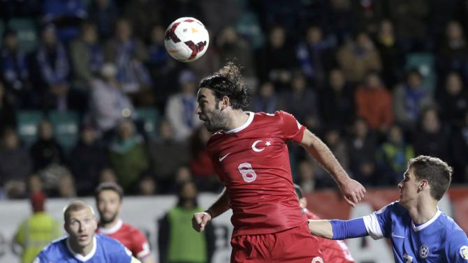 Inan of Turkey heads the ball during their 2014 World Cup qualifying soccer match against Estonia in Tallinn