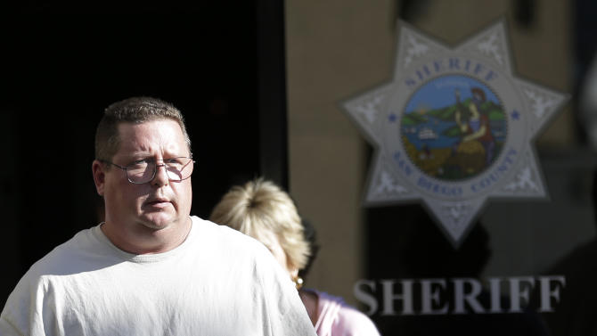 Brett Anderson, the father of missing children 16-year-old Hannah Anderson and 8-year-old Ethan Anderson, arrives to a news conference Tuesday, Aug. 6, 2013, in San Diego. Anderson, the husband of a Christina Anderson, whose body was found in a burned house near the U.S.-Mexico border, said Tuesday that he knew the man suspected of killing his wife and abducting one or both of their children. (AP Photo/Gregory Bull)