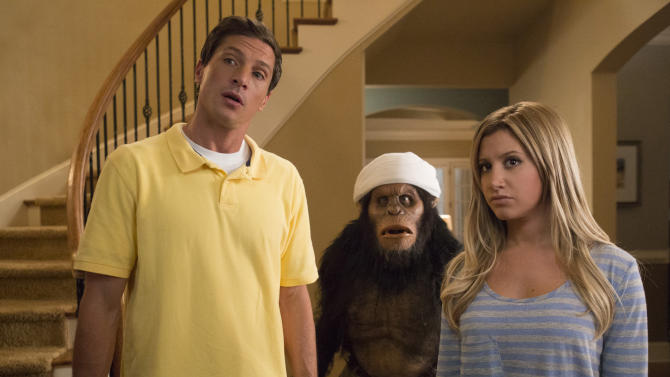 "This film publicity image released by Dimension Films/The Weinstein Co. shows Simon Rex, left, and Ashley Tisdale in a scene from ""Scary Movie 5."" (AP Photo/Dimension Films/The Weinstein Co., Quantrell D.Colbert)"