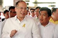President Aquino confers with acting ARMM Gov. Mujiv Hataman during the ARMM Convention on Local Governance in Davao City last June.