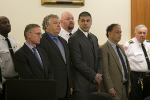 Aaron Hernandez, center, stands as the verdict is read in his murder trial. (AP)