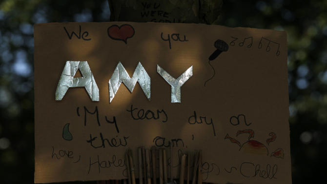 A tribute left for British singer songwriter Amy Winehouse outside her house in London on the first anniversary of her death, Monday, July 23, 2012. (AP Photo/Sang Tan)