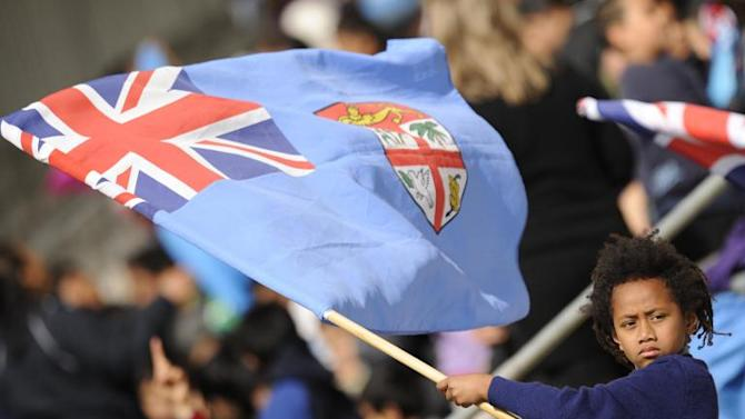 A young fan waves Fiji flag ahead of a rugby union match at Porirua Park in Wellington, on September 13, 2011