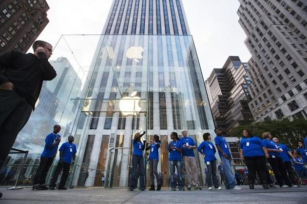 Apple employees line up outside of the Apple Store on 5th Avenue for the release of Apple's iPhone 5 in New York