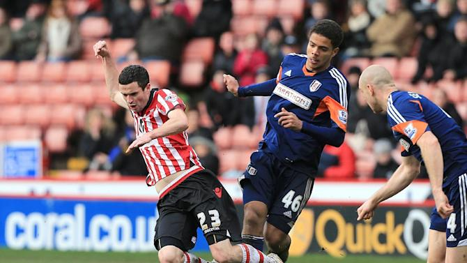 Sheffield United's Jamie Murphy, left, is tackled by Fulham's Joshua Passley during their FA Cup, Fourth Round soccer match at Bramall Lane, Sheffield, England, Sunday Jan. 26, 2014