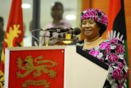 Malawi's new President Joyce Banda delivers a speech at her inauguration. Banda offered the conciliatory words following two days of political intrigue in which Mutharika's inner circle tried to block her assuming the post, which fell to her as vice president under the terms of the constitution
