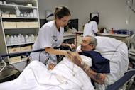 Members of Nord Hospital take care of a sick man at the emergency ward in February 2012 in Marseille, southern France. Nurses should go on the offensive against YouTube videos that stereotype them as sexual playthings or witless, according to a report published in a nursing journal