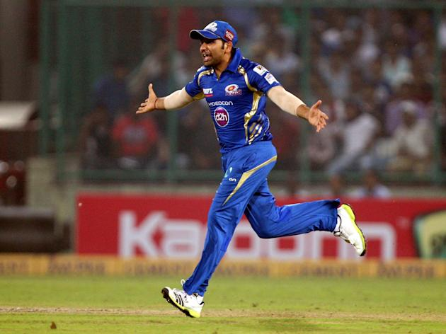 Mumbai Indians captain Rohit Sharma celebrate after wining the final match between Rajasthan Royals and Mumbai Indians at Feroz Shah Kotla stadium, in Delhi on Oct. 6, 2013. (Photo: IANS)